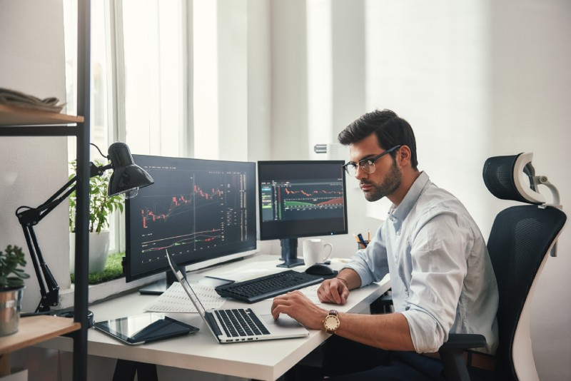 Young forex trader at their desk