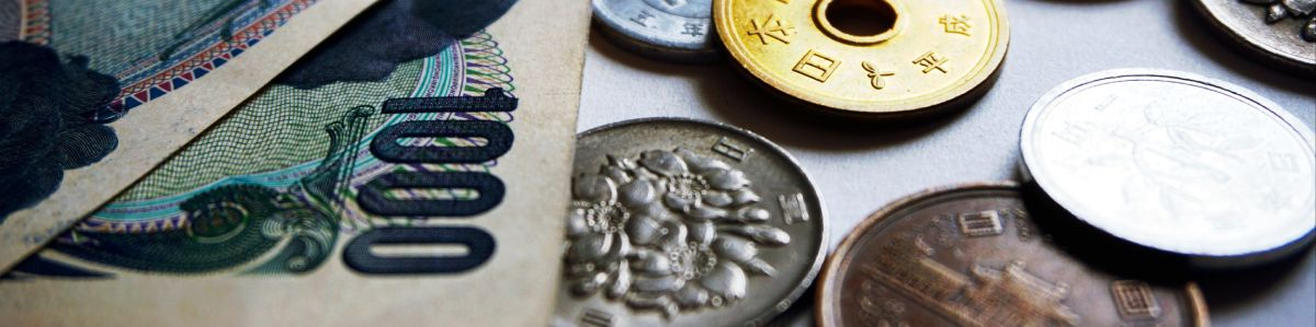 Chinese coins and notes scattered on a table