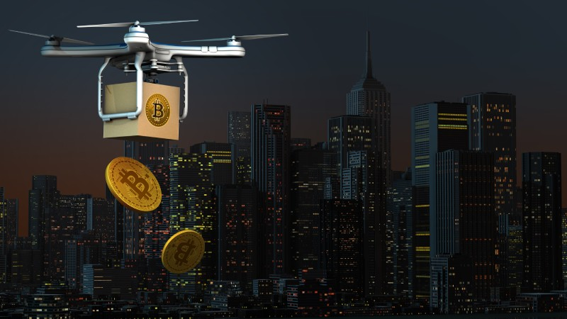 Drone flying about city airdropping bitcoins