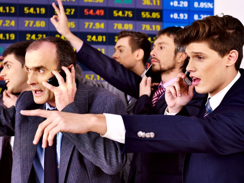 Multiple traders talking on their mobiles
