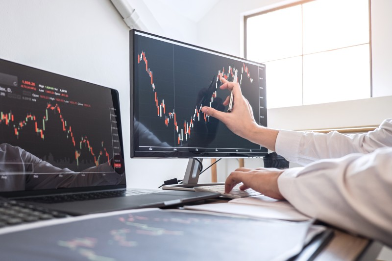 Trader monitoring trading charts