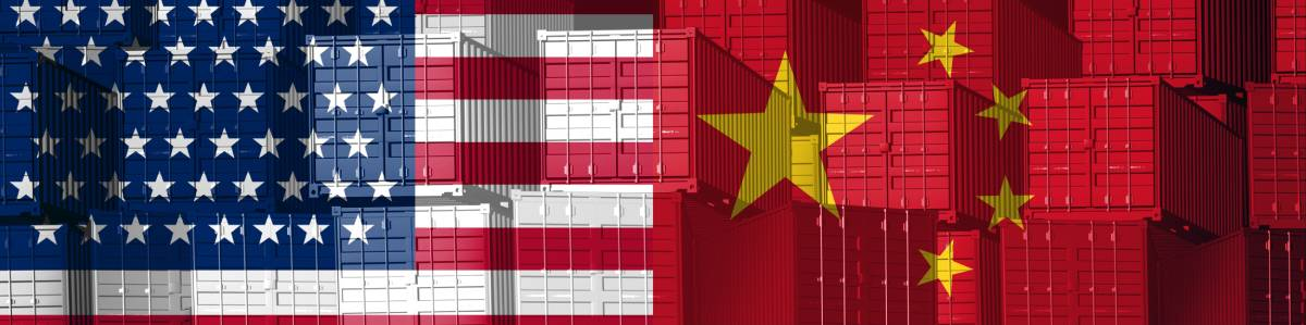 Wall of shipping containers with USA and China flags covering them